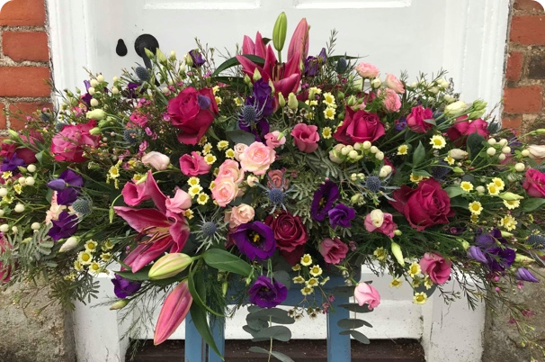Colourful flower arrangement provided by Belle, flower delivery new forest & florist beaulieu.