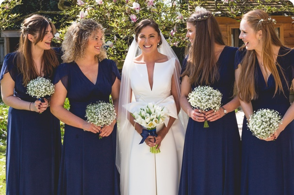 Bride holding flowers provided by leading florist new forest & flower delivery beaulieu.
